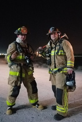 Tech. Sgt Mark McKunes (right) poses for a picture with a fellow firefighter recently at an undisclosed location. McKune is deployed from the 439th Airlift Wing, Westover Air Reserve Base, Massachusetts.