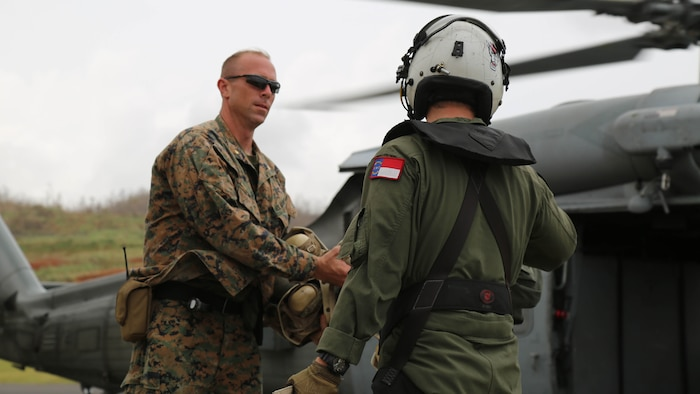 Gill and his Marines provide security and stability at landing zones and at the U.S. Department of State's evacuation control center at the airport.