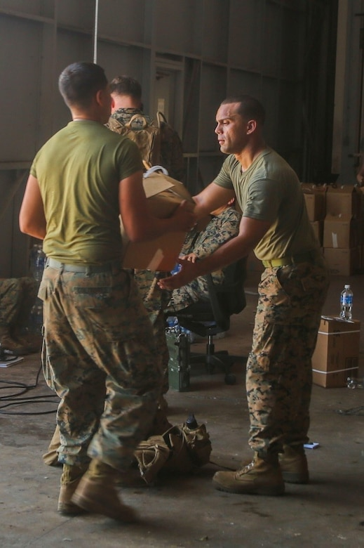 Marines unload relief supplies.