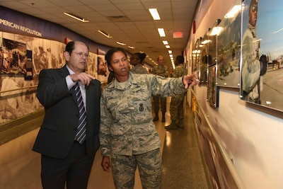 Civilian and airman tour new National Guard display.