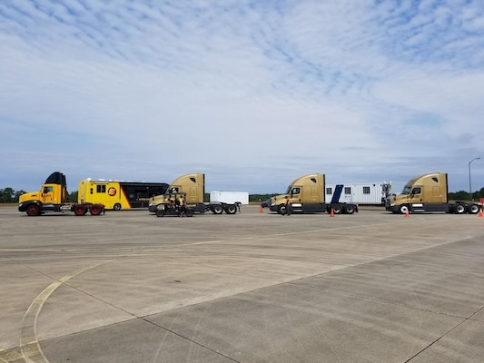 Trucks wait to retrieve trailers of hurricane relief supplies at Fort Bragg before carrying these supplies to a port in Florida.  The Federal Emergency Management Agency and Defense Logistics Agency are coordinating the distribution of hundreds of trailers filled with food, water, generators and other relief supplies for areas hit by hurricanes in recent weeks.