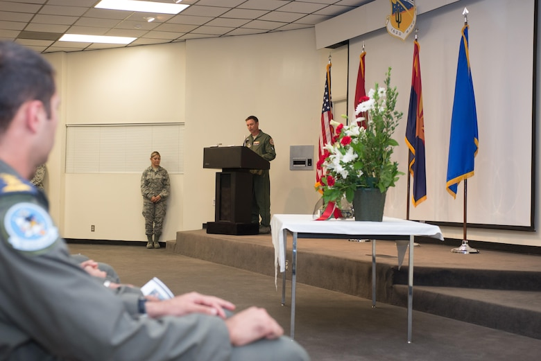 """Director of Operations for the 152nd Fighter Squadron Detachment 1, Lt. Col. Jason Lewis speaks at a memorial service here Sept. 19.  """"He gave his life for God and country in preparation for battle with ISIS and any other threat that serves to alter peace and civility in Iraq.  We owe our utmost reverence, for he is a true hero,"""" said Lewis.  """"Know your bothers will take it from here and will ensure your sacrifice was not made in vein.""""  (U.S. Air National Guard Photo by 1st Lt. Lacey Roberts)"""