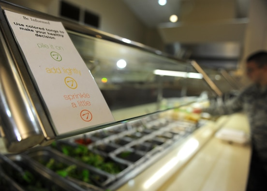 A placard designed for the Department of Defense's Go for Green program is used to make healthy choices Oct. 3, 2017, at the Hercules Dining Facility on Little Rock Air Force Base, Ark. The program is available at most DOD dining facilities, which uses a green, yellow, and red color-code to identify nutritious foods and make healthy food choices easier. (U.S. Air Force photo by Airman 1st Class Grace Nichols)