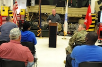 Paul Harvey, the heavy mobile equipment repairer supervisor for Area Maintenance Support Activity 131, in Jeffersonville, Indiana, speaks to his shop and Maj. Gen. Patrick Reinert, commanding general of the 88th Regional Support Command, during an awards ceremony honoring AMSA 131 for winning of the Level I, Company TDA category of the Fiscal Year 2016 Supply Excellence Awards (SEA) for the U.S. Army Reserve.
