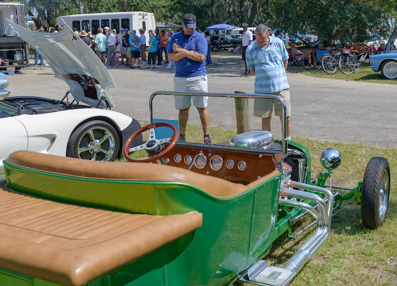 Petty Officer 2nd Class Gelardo BurgesAviles, Aerographers Weather School student and Chief Master Sgt. Harley Delp, Pennsylvania Air National Guard 111th Attack Wing communication flight superintendent, inspect a 1923 Model T Roadster at The Marina Park during the 14th Annual Cruisin' Keesler Car Show Sept. 30, 2017, on Keesler Air Force Base, Mississippi. The annual car show is held to kick off Cruisin' the Coast, a festival to celebrate classic cars, trucks and hot rods, where vehicles cruise down on the 30-mile beachside highway in Mississippi. There were over 300 visitors and 130 classic vehicle entries with 15 awards presented. (U.S. Air Force photo by Andre' Askew)