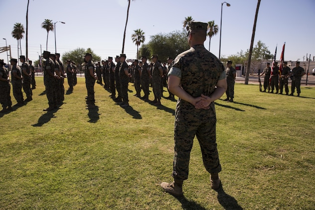 U.S. Marine Corps Gunnery Sgt. Jason Hope, the Marine Corps Air Station (MCAS) Yuma, Ariz., Headquarters and Headquarters Squadron squadron gunnery sergeant, forms the troops during Sgt. Maj. Delvin R. Smythe's, the MCAS Yuma sergeant major, retirement ceremony, June 30, 2017. (U.S. Marine Corps photo taken by Lance Cpl. Christian Cachola)