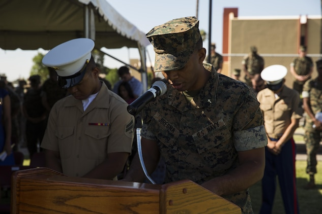 U.S. Navy Lt. Abraham Jiregna, a chaplain with Marine Corps Air Station (MCAS) Yuma, Ariz., gives the invocation during Sgt. Maj. Delvin R. Smythe's, the MCAS Yuma sergeant major, retirement ceremony, June 30, 2017. (U.S. Marine Corps photo taken by Lance Cpl. Christian Cachola)