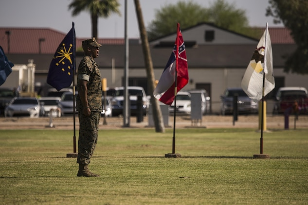 U.S. Marine Corps Staff Sgt. Matthew Bradley, the adjutant for the ceremony, calls troops to order during Sgt. Maj. Delvin R. Smythe's, the Marine Corps Air Station Yuma, Ariz., sergeant major, retirement ceremony, June 30, 2017. (U.S. Marine Corps photo taken by Lance Cpl. Christian Cachola)