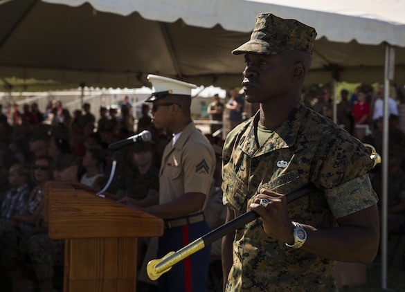 U.S. Marine Corps Sgt. Maj. Delvin R. Smythe, the Marine Corps Air Station (MCAS) Yuma, Ariz., segeant major, transfers the sword to Master Gunnery Sgt. Arthur Parra, who will serve as an acting sergeant major, during Sgt. Maj. Smythe's retirement ceremony, June 30, 2017. (U.S. Marine Corps photo taken by Lance Cpl. Christian Cachola)