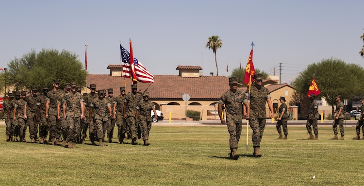 U.S. Marines with Marine Corps Air Station (MCAS) Yuma, Ariz., Headquarters and Headquarters Squadron conduct a pass in review during Sgt. Maj. Delvin R. Smythe's, the MCAS Yuma sergeant major, retirement ceremony, June 30, 2017. (U.S. Marine Corps photo taken by Lance Cpl. Christian Cachola)