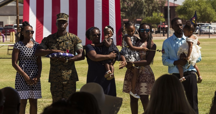 U.S. Marine Corps Sgt. Maj. Delvin R. Smythe, the Marine Corps Air Station (MCAS) Yuma, Ariz., sergeant major, completes the ceremony with his family during Sgt. Maj. Smythe's retirement ceremony, June 30, 2017. (U.S. Marine Corps photo taken by Lance Cpl. Christian Cachola)