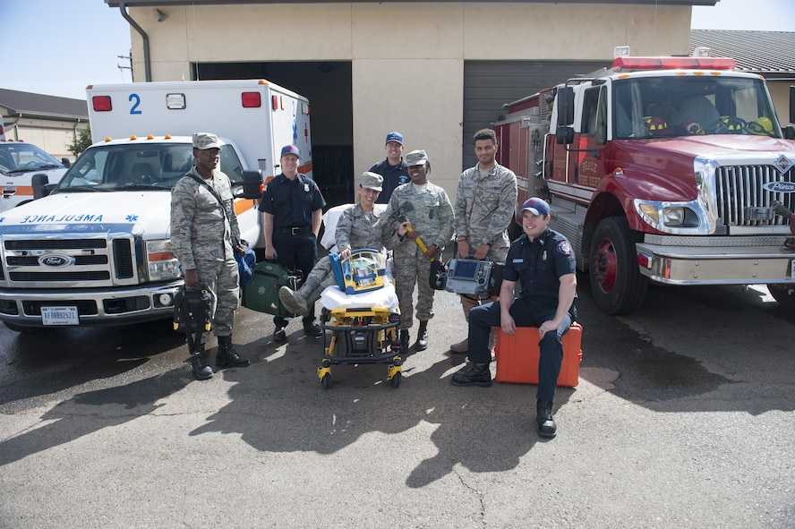 Airmen with the 9th Medical Group and 9th Civil Engineer Squadron, pose for  a photo at Station 2 at Beale Air Force Base, California, Oct. 3, 2017. Medics relocated to the fire station in an attempt to reduce radio issues caused by lack of reception on base. (U.S. Air Force photo/Senior Airman Justin Parsons)