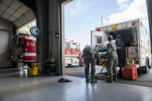 Medics with the 9th Medical Group, restock an ambulance with gear at Station 2 at Beale Air Force Base, California, Oct. 3, 2017. Medics and firefighters at Station 2 are dispatched over the same system decreasing the time it takes for members to respond to calls. (U.S. Air Force photo/Senior Airman Justin Parsons)