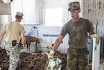 Soldiers with the Florida Army National Guard's 753rd Brigade Engineer Battalion's Company A, muck out homes in Big Pine Key left devastated by Hurricane Irma. This team is one of several working with residents in the Florida Keys to remove some of the debris and allow them to return to their homes.