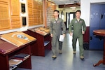 Two Japan Air Self-Defense Force pilots are on their way to a classroom for training at Joint Base San Antonio-Randolph, Texas, October 2, 2017.  Nine more international officers are currently training with the 435th Fighter Training Squadron's Introduction to Fighter Fundamentals program.  (U.S. Air Force photo by Randy Martin)  (171002-F-ET654-006.JPG)