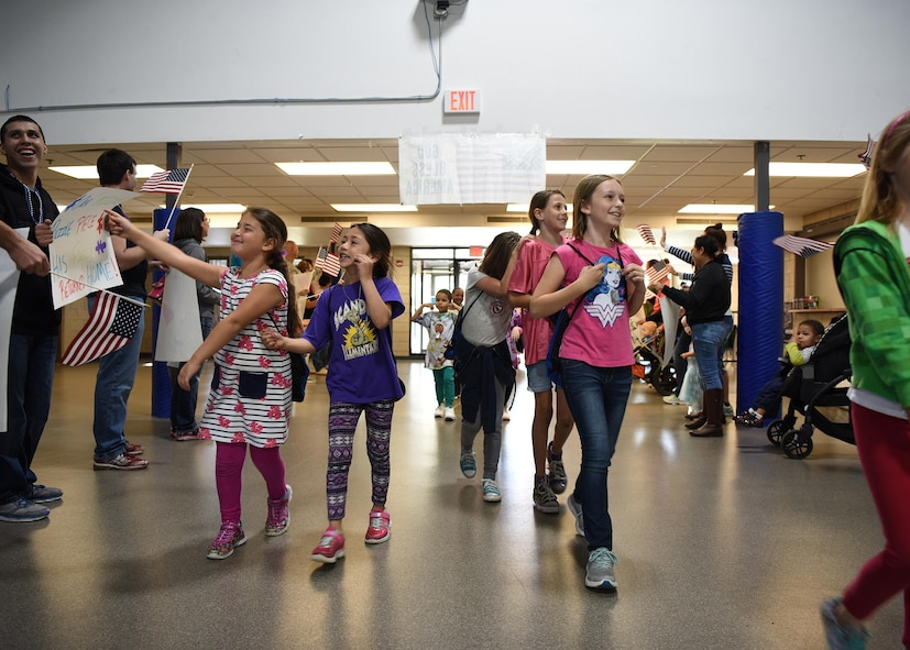 Children from the kid's deployment day event arrive at their welcome home party after spending the day doing mock deployment activities Sept. 29, 2017, at Grand Forks Air Force Base, North Dakota. The event was sponsored by the Network 5/6 and featured activities such as a military working dog demo, combat zombie activity, self-aid buddy care and an obstacle course. (U.S. Air Force photo/Senior Airman Cierra Presentado)