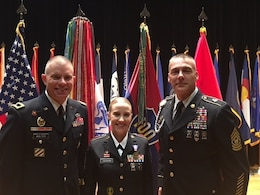 (Left to right) Brig. Gen. Aaron Walter, 100th Training Division commander, Sgt. 1st Class Alicia Hofmann, and Command Sgt. Maj. Andrew Lombardo, command sergeant major for the 100th TD, pose for photographs at Hofmann's award ceremony held at Fort Knox, Kentucky, Sept. 29, 2017. Assigned to the 8th Regiment, 100th Health Services Battalion, 4th Brigade, 100th Training Division, Hofmann was awarded the Soldier's Medal for risking her life to save a man from a car accident that occurred on Oct. 4, 2014 in Saline, Michigan. (Photo by Sgt. 1st Class Nang Cash, 100th Training Division Operations NCOIC)