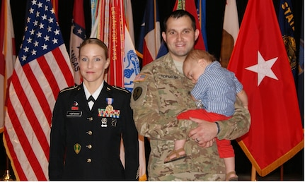 (Left to right) Sgt. 1st Class Alicia Hofmann, her husband Staff Sgt. David Hofmann, and one-year-old son Luke pose for photographs at Sgt. 1st Class Hofmann's Soldier's Medal ceremony held at Fort Knox, Kentucky, Sept. 29, 2017. She was awarded the Soldier's Medal for risking her life to save a man from a car accident that occurred on Oct. 4, 2014 in Saline, Michigan.