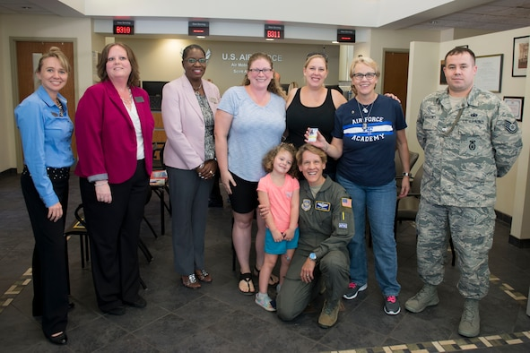 Fallen Airman's sister receives Scott's first Gold Star Family Card
