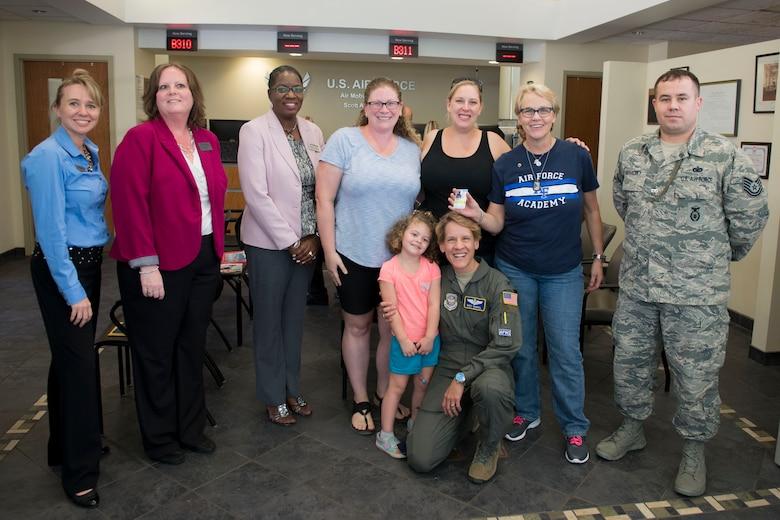 Fallen Airman's sister receives Scott's first Gold Star Family Card