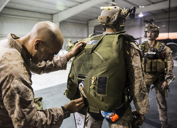 Marines with the Force Reconnaissance Company, III Marine Expeditionary Force stationed at Camp Schwab in Okinawa, Japan run though Jumpmaster Parachute Inspections (JMPIs) at IDIS-Corps facility in Parker, Ariz., from July 12 to Aug 1, 2017. The Marines conducted high altitude high opening (HAHO) sustainment training, while implementing the Joint Precision Air Drop System (JPADS).  During JMPIs, the jumpmaster checks the jumpers oxygen mask is properly working and checks  gear and ensures everything is in position and ready for the parachute's release.