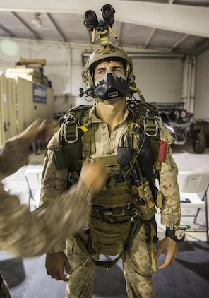 Marines with the Force Reconnaissance Company, III Marine Expeditionary Force stationed at Camp Schwab in Okinawa, Japan run though their Jump Master Parachute Inspections (JMPIs) at IDIS-Corps facility in Parker, Ariz., from July 12 to August 1, 2017. The Marines conducted high altitude high opening (HAHO) sustainment training, while implementing the Joint Precision Air Drop System (JPADS).   During JMPIs, the jumpmaster checks the jumpers oxygen mask is properly working and checks  gear and ensures everything is in position and ready for the parachute's release.