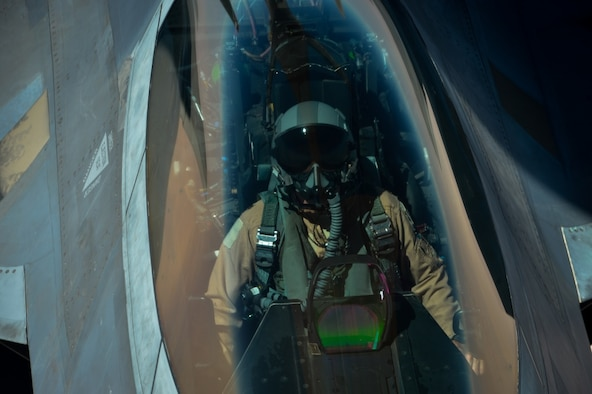 An Air Force F-22 Raptor receives fuel from a KC-135 Stratotanker.