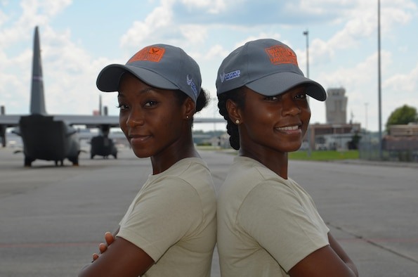 Shaina Williams, left, and Shannon Barber, Dobbins 94th Airlift Wing development and training flight trainees, pose for a photo on the flightline at Dobbins Air Reserve Base, Ga. July 9, 2017. Williams and Barber are identical twins and are preparing to go to basic military training later this year. (U.S. Air Force photo/Senior Airman Lauren Douglas)