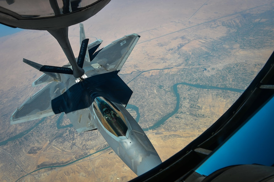 A U.S. Air Force F-22 Raptor departs after receiving fuel from a KC-135 Stratotanker, assigned to the 340th Expeditionary Air Refueling Squadron, during a mission in support of Operation Inherent Resolve Aug. 29, 2017. The F-22 is a component of the Global Strike Task Force, supporting U.S. and Coalition forces working to liberate territory and people under the control of ISIS. (U.S. Air Force photo by Staff Sgt. Michael Battles)