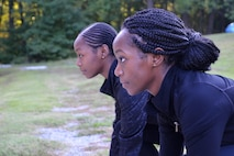 Shaina Williams, foreground, and Shannon Barber, 94th Airlift Wing development and training flight trainees, prepare to run at the base track at Dobbins Air Reserve Base, Ga. Sept. 10, 2017. Both sisters ran track and field at Georgia State University before enlisting in the Air Force Reserve. (U.S. Air Force photo/Senior Airman Lauren Douglas)