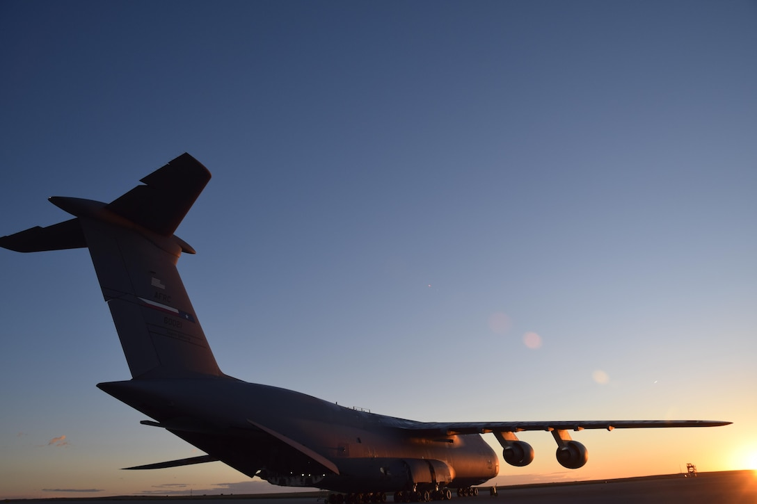 An Air Force Reserve Command C-5M Super Galaxy, which is assigned to the 433rd Airlift Wing at Joint Base San Antonio-Lackland, Texas, awaits cargo and personnel in Colorado Springs, Colorado, Oct. 1, 2017.  The mission included transporting 11 Soldiers from the 247th Composite Supply Company, 68th Sustainment Support Battalion, 4th Sustainment Brigade, 4th Infantry Division, supplies, fuel trucks and a communications vehicle to be employed in Hurricane Maria relief efforts in Puerto Rico. (photo by Tech. Sgt. Carlos J. Treviño)