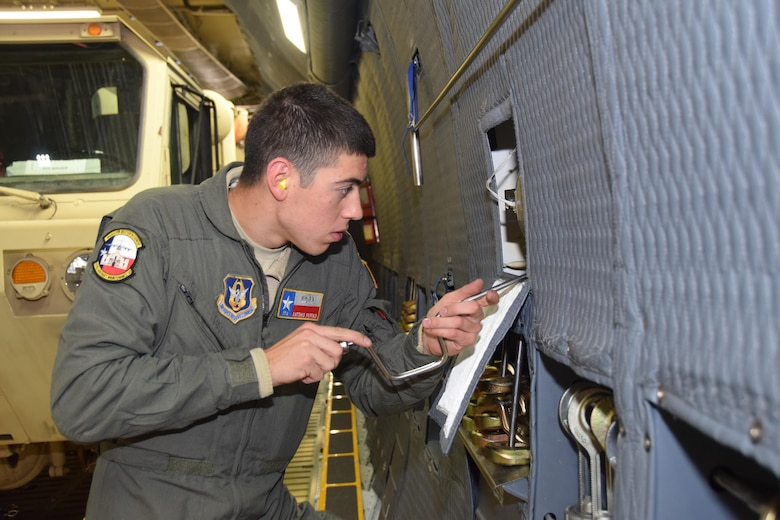 Senior Airmen Antonio Farias, 433rd Aircraft Maintenance Squadron crew chief, fixes an exterior light on a C-5M Super Galaxy, operated by Air Force Reserve Citizen Airmen with the 433rd Airlift Wing in Colorado Springs, Colorado.  Farias was part of an aircrew taking Soldiers from the 247th Composite Supply Company, 68th Sustainment Support Battalion, 4th Sustainment Brigade, 4th Infantry Division, supplies, fuel trucks and a communications vehicle to be employed in relief efforts in Puerto Rico after Hurricane Maria struck the commonwealth with Category 4 winds. (U.S.  Air Force photo by Tech. Sgt. Carlos J. Treviño)