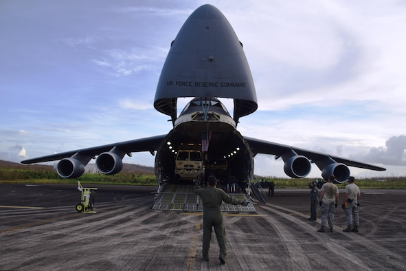 Master Sgt. Michael Lopez, 68th Airlift Squadron loadmaster, directs a vehicle off of a C-5M Super Galaxy, flown by Air Force Reserve Citizen Airmen with the 433rd Airlift Wing from Joint Base San Antonio-Lackland, Texas, after landing at Ceiba, Puerto Rico Oct. 1, 2017. The Alamo Wing's Reserve Citizen Airmen have flown 17 missions during the past month to aid hurricane recovery efforts in the United States and its territories to include Puerto Rico and the U.S. Virgin Islands.  (U.S.  Air Force photo by Tech. Sgt. Carlos J. Treviño