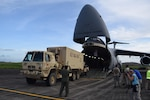 A Joint Incident Site Communications Capability (JISCC) vehicle is unloaded from an Air Force Reserve Command's 433rd Airlift Wing C-5M Super Galaxy at Ceiba, Puerto Rico Oct. 1, 2017. The C-5M, flown by Reserve Citizen Airmen from Joint Base San Antonio-Lackland, Texas, took the JISCC, 11 Soldiers,  supplies and two fuel trucks to Puerto Rico to aid hurricane recovery efforts that have affected the United States and its territories  in the Caribbean. (U.S.  Air Force photo by Tech. Sgt. Carlos J. Treviño)
