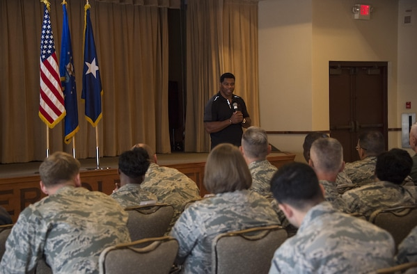 Herschel Walker, former professional athlete, speaks to Thunderbolts during his visit to Luke Air Force Base, Ariz., Oct. 3, 2017. Walker's speech encouraged Airmen to be resilient and never give up even through life's toughest times. (U.S. Air Force photo/Airman 1st Class Alexander Cook)
