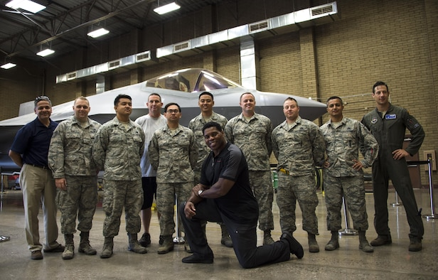 Herschel Walker, former professional athlete, takes a group photo with Airmen assigned to the 62nd Aircraft Maintenance Unit at Luke Air Force Base, Ariz., Oct. 3, 2017. During his visit, Walker went to various units around base to interact and spend one-on-one time with Airmen. (U.S. Air Force photo/Airman 1st Class Alexander Cook)