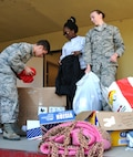 Beale Airmen pack donated clothes and goods.