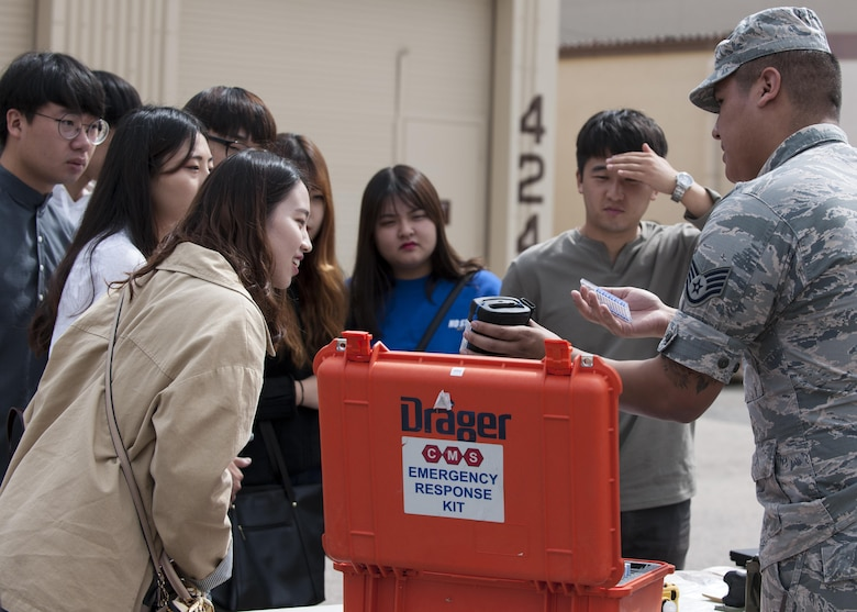 "U.S. Air Force Staff Sgt. Antonio Aguilera, 8th Medical Group Bioenvironmental Engineering readiness and training NCOIC, explains the contents of an Emergency Response Kit to environmental engineering students of Kunsan National University during a tour at Kunsan Air Base, Republic of Korea, Sept. 29, 2017. During the tour, students were taught about what steps are taken to ensure mission-ready medics ensuring ""Fight Tonight"" capability. (U.S. Air Force photo by Staff Sgt. Victoria H. Taylor)"