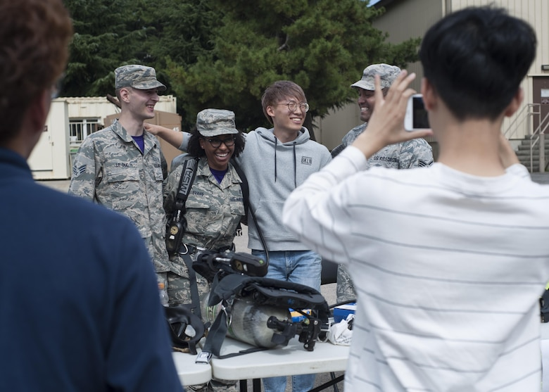 "U.S. Air Force Airmen and environmental engineering students from Kunsan National University pose for a photo while visiting Kunsan Air Base, Republic of Korea, Sept. 29, 2017. During the tour, students were taught about what steps are taken to ensure mission-ready medics to strengthen the Wolf Pack's ""Fight Tonight"" capability. (U.S. Air Force photo by Staff Sgt. Victoria H. Taylor)"