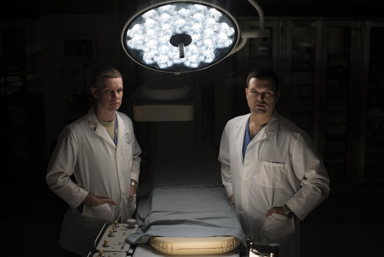 Lt. Col. Jason Compton and Maj. Charles Chesnut, 99th Medical Group general surgeons, pose for a portrait in the Mike O'Callaghan Military Medical Center at Nellis Air Force Base, Nev., Oct. 3, 2017. The surgeons were two members of the team that took in trauma patients at the University Medical Center of Southern Nevada during the Las Vegas shooting, Oct. 1, 2017.  (U.S. Air Force photo by Senior Airman Kevin Tanenbaum)