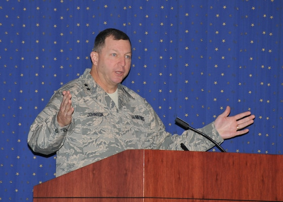 Two-star AF general speaking at lecturn.