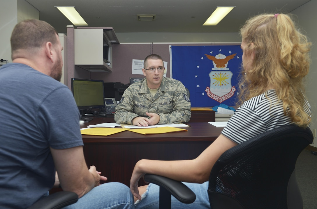 Air Force recruiter talks with prospect and parents.