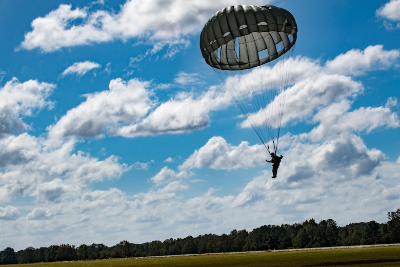 A member of the 820th Base Defense Group (BDG) descends during a static-line jump, Oct. 3, 2017, at the Lee Fulp drop zone in Tifton, Ga. The 820th Combat Operations Squadron's four-person shop of parachute riggers are responsible for ensuring every 820th BDG parachute is serviceable, while also ensuring ground safety at the drop zone. The team has packed and inspected more than 490 parachutes in 2017. (U.S. Air Force photo by Airman 1st Class Daniel Snider)