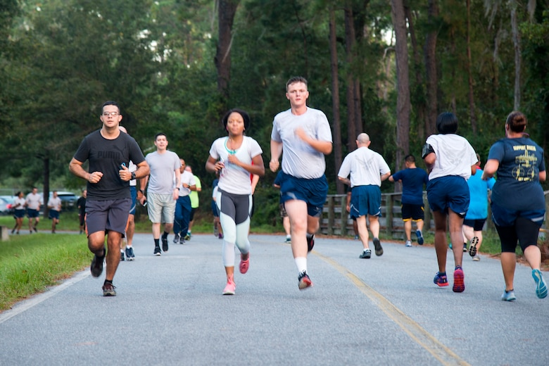Airmen run during a Violence Prevention Awareness 5K, Oct. 4, 2017, at Moody Air Force Base, Ga. Moody leadership proclaimed October as Violence Prevention Awareness Month in order to recognize and educate Airmen and families about suicide prevention, drug abuse, stalking awareness and domestic violence prevention. (U.S. Air Force photo by Airman 1st Class Erick Requadt)