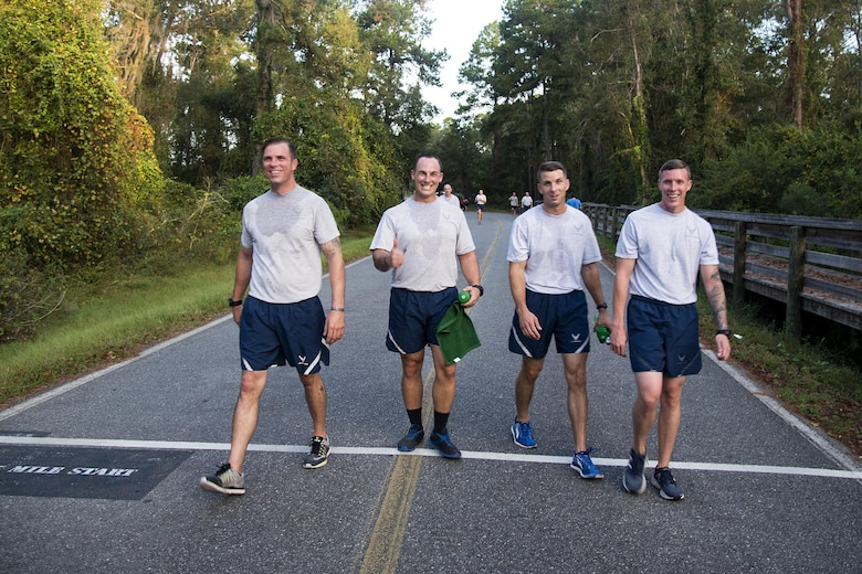 Airmen from the 820th Base Defense Group smile while crossing the finish line of a Violence Prevention Awareness 5K, Oct. 4, 2017, at Moody Air Force Base, Ga. Moody leadership proclaimed October as Violence Prevention Awareness Month in order to recognize and educate Airmen and families about suicide prevention, drug abuse, stalking awareness and domestic violence prevention. (U.S. Air Force photo by Airman 1st Class Erick Requadt)