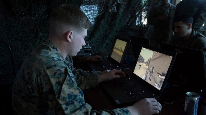 A Marine uses Virtual Battle Space 3 in Marine Corps Base Camp Lejeune, North Carolina. VBS 3 is part of the Tactical Decision Kit developed jointly by Marine Corps Systems Command, the Marine Corps Warfighting Lab's Rapid Capabilities Office and the Office of Naval Research.