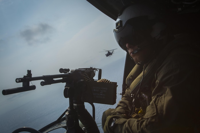 A crew chief with Marine Light Attack Helicopter Squadron 169 observes the ocean while sitting in a UH-1Y Venom over Okinawa, Japan, September 28, 2017. The squadron conducted aerial live-fire training in Okinawa, which is crucial to maintaining a stronger, more capable, forward deployed force in the Indo-Asia-Pacific region. The aircraft is assigned to HMLA-169, Marine Aircraft Group 39, 3rd Marine Aircraft Wing, currently forward deployed under the unit deployment program with MAG-36, 1st MAW.