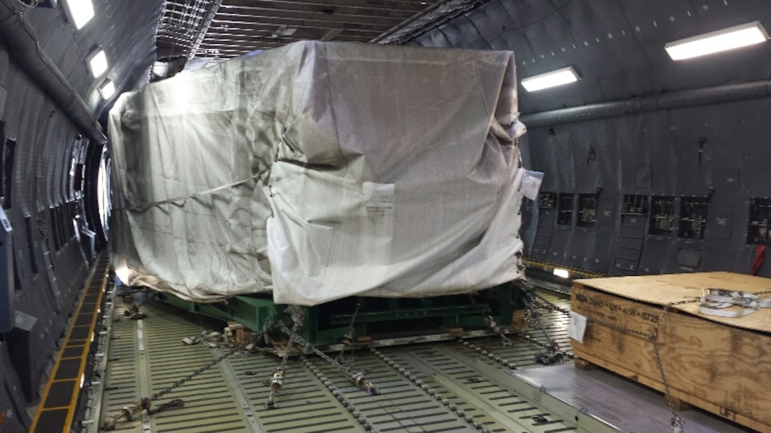 A sonar window dome being transported in a C-5 aircraft, to repair the USS Antietam, a Ticonderoga class cruiser ship which was damaged after running aground in Tokyo Bay, Japan earlier in the year. The Air Force Life Cycle Management Center's Air Transportability Test Loading Activity office located at Wright-Patterson Air Force Base, certified that the load was safe for flight and designed fixtures to restrain and protect it. (courtesy photo)
