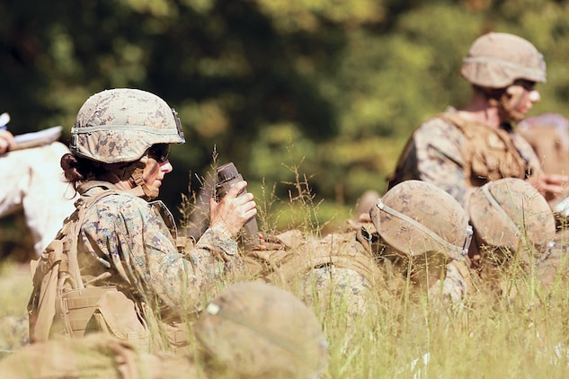 Marines participate in an exercise during the Infantry Officer Course aboard Quantico, Virginia, Aug. 10, . The first female Marine to complete the course graduated Sept. 25.