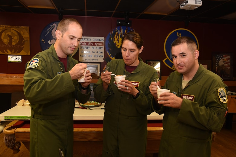 Judges for the 964th Airborne Air Control Squadron's Chili Cook-Off sample one of the entries in the contest.